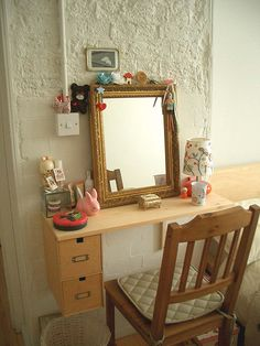 Definitely needs to be prettier but i like the idea of the mirror. diy vanity for bedroom? ? #Anthropologie