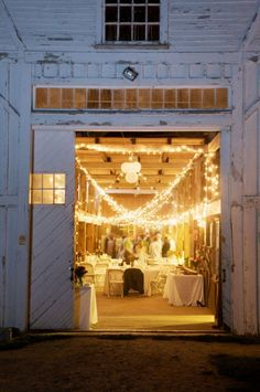 There's something cozy about a wedding reception in a big ole barn with tons of twinkling lights.