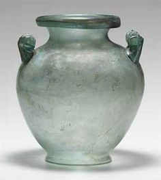 A ROMAN GLASS CINERARY URN  CIRCA 1ST-2ND CENTURY A.D