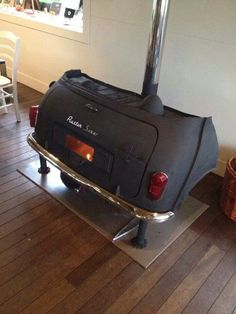 Recycled car trunk fireplace. Shared by www.highroadorganizers.com
