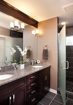 Warm color scheme bathroom with a pop of light from the chrome hardware