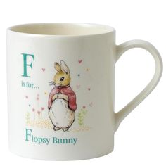 This perfect personalised present has been beautifully decorated using the original illustrations from the Beatrix Potter stories. This letter F mug features the much loved character, Flopsy. Each mug is presented in our new style branded craft box. Material; Ceramic. Dishwasher and microwave safe.