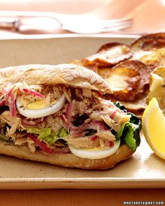 Reinvent a traditional nicoise salad by tucking it into a sandwich. Here, we've piled tuna, eggs, olives, and onions between slices of crusty ciabatta.