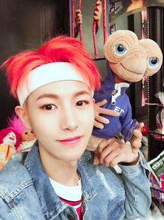 Renjun of NCT DREAM My Renjun looks so handsome with that vibrant orange hair!! He is so cute with that stuffed E.T. toy!!