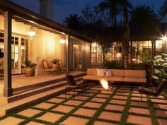 A fire pit adds atmosphere to an outdoor area of this historic 1920 John Byers U-shaped hacienda set in the Santa Monica Mountains in the Pacific Palisades Riviera. More: Choose a  unique fire pit design .