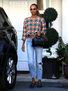 On Jasmine Tookes: Quay All My Love Sunglasses ($60); Givenchy Antigona Mini-Duffel ($1750); John Hardy The Modern Chain 18k Gold Band Ring With Diamonds ($2500); Gucci Jordaan Leather Loafer...