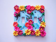 Polymer clay light switch plate by DawnsClayFantasy on Etsy, $18.50
