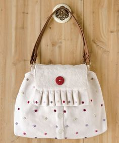 Mary Ann Haak's handbag is upcycled from a darling, dotted sweater.   Haute Handbags