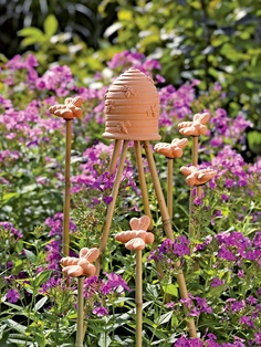 Use these Honeybee Finials from Gardener's Supply Company to top bamboo stakes in your garden and give them a finished look.