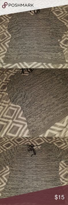 Maurices Sweater Grey lightweight sweater with sparkle threaded throughout. 3/4 sleeves, tie back detail. Sweater is a little see through, would recommend a cami underneath. Size L. Excellent condition. Bundle & save 20%!🛍  I do my very best to describe my items as they are shown. I inspect each item before posting to sell. I encourage interested buyers to please ask any questions and to utilize the zoom on photos to inspect before buying.   Also on ➡️Ⓜ️ Maurices Sweaters