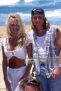 American actors Pamela Anderson and Jaason Simmons, who appear in the television show 'Baywatch', promote the Coca Cola Surf Classic event at Bondi Beach on December 03, 1994 in Sydney, Australia.