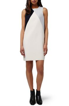 Effortless colorblocking done right with this darling Topshop shift dress from the Nordstrom Anniversary Sale. Raw edges at the armholes and hem add to its overall minimalist aesthetic.