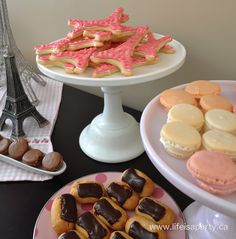 Paris Party Food -A French Themed Menu  Great ideas of what to serve at your Paris themed party, from baguettes to macarons!  Beautiful and delicious!