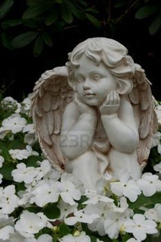 Angel Figure In A Bed At The Cemetery. Stock Photo, Picture And Royalty Free Image. Angel Sculpture, Sculpture Art, I Believe In Angels, Garden Angels, Angel Pictures, Angel Art, Garden Statues, Cemetery, Garden Art
