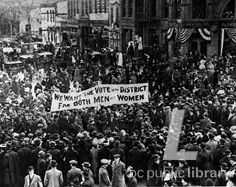 """Banner asks Vote for Both Men and Women in the District at suffrage parade. 1913-Historical Image Collection    From the Washingtoniana """"Women's Suffrage Movement"""" photo gallery."""