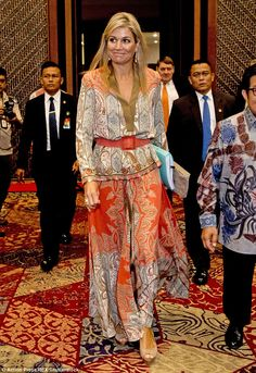 The royal greets locals as she arrives at the conference. Maxima wore her…