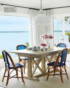 The dining room wall paint color is Benjamin Moore White Drifts. Trim paint color is Benjamin Moore Decorator's White. Andrew Howard Interior Design