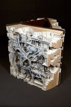 BRIAN DETTMER's gorgeous altered books made from encyclopedias!  LOVE it.