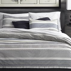 Shop Medina Duvet Covers and Pillow Shams.  Upon closer look, contemporary stripes of tonal blues reveal intricate traditional Indian filigree patterns.