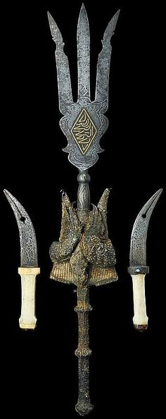 "Sudanese Persian style trident, 19th century, engraved tip decorated with brass symbols; the grip covered with reptile skin and holding   two daggers wit, engraved pierced blades and bone grips. Scarce.Illustrated in ""Islamic and Native Weapons of Colonial Africa 1800 -1960"" by A. C. Tirri, page 40. These were the types of weapons used by the forces of the Mahdi during the Islamic uprising in Sudan during the late 1800s."