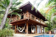 A raised wooden house in a tropical style . Bamboo House Design, Tropical House Design, Tropical Houses, Tropical Style, Country House Design, Bungalow House Design, Hut House, House On Stilts, Retreat House