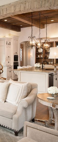 Love the warmth in this all white kitchen. Jodie Bolagiano Interior Design