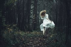 White dress in movement. she ran away from me but all i could was stare because beauty ran away from me.