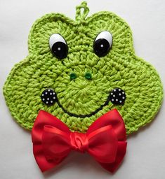 Crocheted Frog/Toad Potholder Decoration with Bow Made With Cotton Yarns Crochet Applique Patterns Free, Crochet Coaster Pattern, Granny Square Crochet Pattern, Crochet Motif, Crochet Hats, Crochet Frog, Crochet Hot Pads, Crochet Potholders, Crochet Decoration