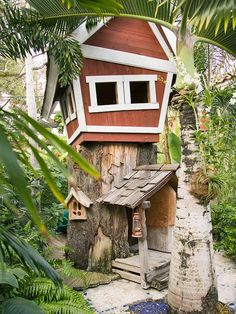 A fanciful playhouse design offers plenty of space for childhood fun. The playhouse's eccentricity extends to the walkway, part graduated wood path, part randomly mortared mosaic tiles. The site of a playhouse depends on budget constraints, elements in the yard, and imagination. This playhouse takes advantage of an old tree trunk to loft a structure. The details of a playhouse can reinforce the sense of childhood whimsy, such as the geometry of this siding and windows. Another benefit of…