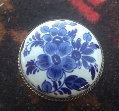 A personal favorite from my Etsy shop https://www.etsy.com/listing/469984793/mallorica-talavera-ceramic-silver-pin