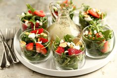Strawberry Salad with Poppyseed Dressing. When it's hot outside, there's nothing better than a crisp, cool salad. One of my favorites is an arugula salad with strawberries, goat cheese and almonds topped with a homemade poppyseed dressing. Tee Sandwiches, Snacks Für Party, Party Appetizers, Party Salads, Tea Party Recipes, Tea Party Foods, Tea Party Menu, Shower Appetizers, Picnic Recipes