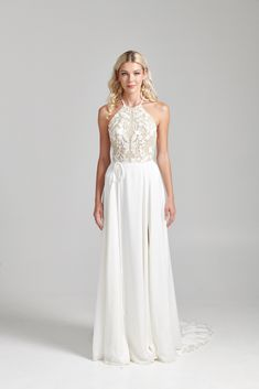 Luxe Spanish embroidered Tulle embellishes this halter neck bodice with a romantic vine motif. The Italian hammered-Satin skirt is romantic in a softly sweeping A-line shape with a slit (optional). Delicate spaghetti strap belt.