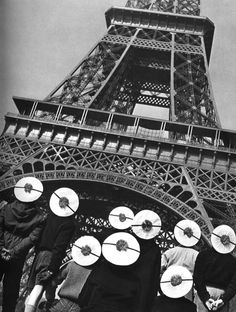 Robert Doisneau // People with sailor's hats in front of the Eiffel tower. Paris, 1955.