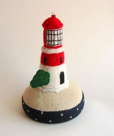 Lighthouses and pincushions - what a great combo.