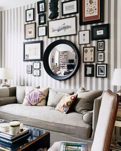 Want to put a gallery wall above the couch but the mirror is an odd shape...