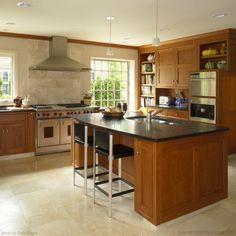 Dark honey cabinets, dark counter, stainless appliances