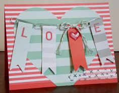 Watermelon Wonder base and added a piece of In Color Envelope Paper. attached the banners through paper clips and secured with Glue Dots. I attached the banners to the heart with Dimensionals and added a piece of Everyday Chic Washi Tape to the bottom.  cut out a heart from Real Red Cardstock using the Itty Bitty Accents Punch Pack and attached it to an Itty Bitty Accents Epoxy Sticker.