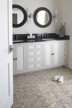 When your bathroom floor makes your bathroom vanity look even better.    Selvaggio Collection stone mosaics