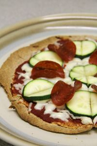 healthy zucchini and pepperoni pizza with a super thin crust