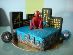 Spiderman cake....maybe instead of fondant icing use cookies placed around it and use regular icing?!