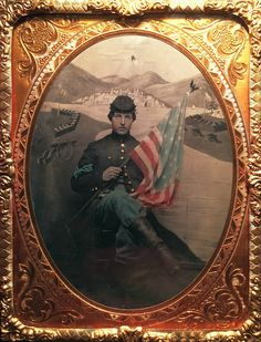 Beautiful tinted quarter plate tintype of a handsome Civil War Color Sergeant