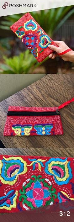 """NWOT! Embroidered Wristlet NWOT. Embroidered wristlet. Size: 4-1/2""""l x 8"""" w. Material: cotton. Wristlet can hold cell, $$ and credit cards/identification. Has middle divider inside. Zipper closure. Bundle discount available. No trades. Bags Clutches & Wristlets"""