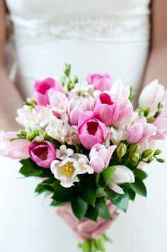 A bouquet of pink and white tulips is beautiful, sophisticated and elegant all at the same time.