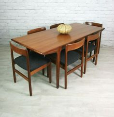 Mid century danish dining set... possibly A.Younger. I have these chairs but can't find a name on them..... could only find a 'J' stamped on the woodwork when I removed the seat.