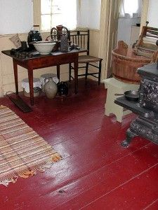 I painted my old apartment's floors this color. Really thinly too, so it looked old and worn down. With the white walls, the red was actually a neutral, believe it or not.