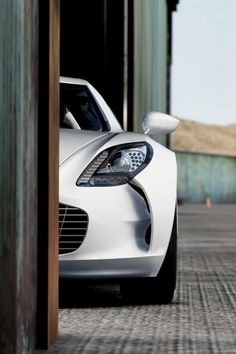 Can anyone guess which gorgeous supercar is hiding in this photo?