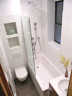 Niches in wall above toilet, wall hung toilet; no shower curtain, simply glass. Small space but ideas for any size bath
