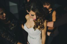 pretty photo of bride getting ready in sun at Aloft Hotel downtown Tampa wedding. Tampa wedding photographer