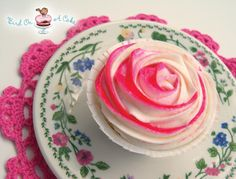 Perfectly Packaged Rose Cupcakes.  I love making these buttercream roses...  they look impressive but are actually quite simple! For these, I decided to add another color to the rose tips.
