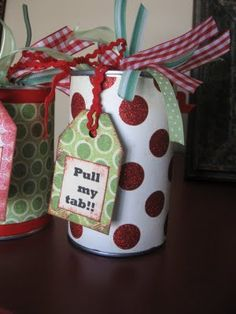 Clever Gift Wrapping Idea | Open a can of soup from the bottom leaving the pull tab on top in place. Thoroughly clean and bleach and hot glue wrapping paper around the outside. Fill with candy, gift card, lotto tickets etc. Hot glue the bottom back on.